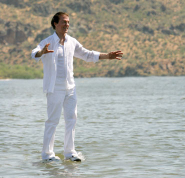 Walking on water - Photo of Andre Kole during a trick illusion of him walking on water, in a way similar to Jesus walking on water.