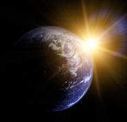 Closeup photo of the earth, with the sun in the background, showing their relative position, a fact that helped convinced this atheist to believe in God.