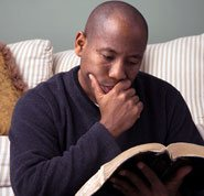 Jesus Christ reveals God to us - Photo of a man reading the Bible to learn more about Jesus Christ.