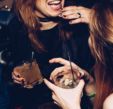 Photo of people drinking alcohol, partying