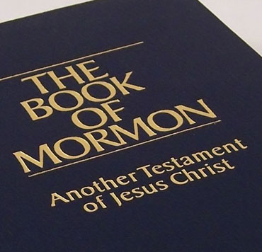 """Close-up of Mormon Bible which says on the cover """"Another Testament of Jesus Christ"""""""