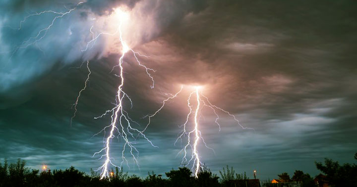 Why is life so hard - Photo of two dramatic sky to ground lightning strikes, to illustrate the difficulties that strike us in life.